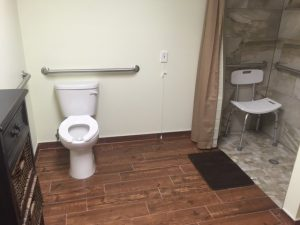 Resident bathroom with emergency pull station at A Country Home Assisted Living Facility.
